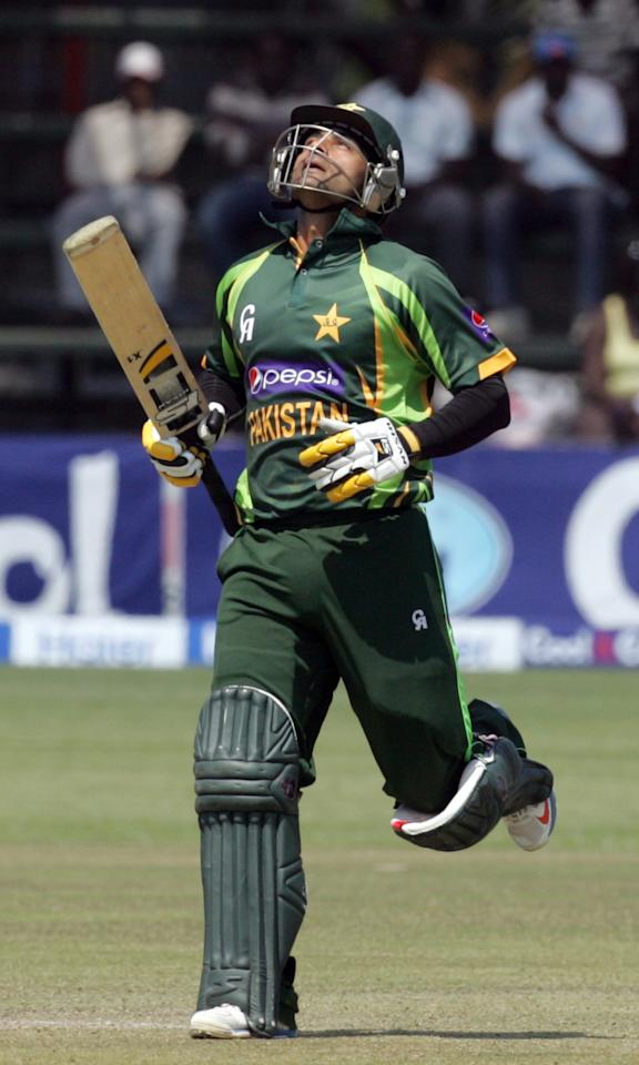 Pakistan batsman Muhammad Hafeez celebrates his century during the 2nd game of the three match ODI cricket series between Pakistan and Zimbabwe at the Harare Sports Club on August 29, 2013 .AFP PHOTO / JEKESAI NJIKIZANA        (Photo credit should read JEKESAI NJIKIZANA/AFP/Getty Images)