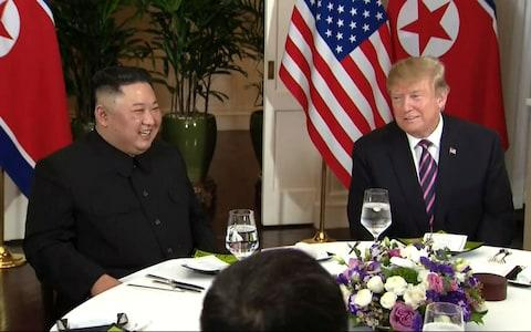 Donald Trump and Kim Jong-un at dinner at the Metropole Hotel in Hanoi - Credit: Broadcast via AP