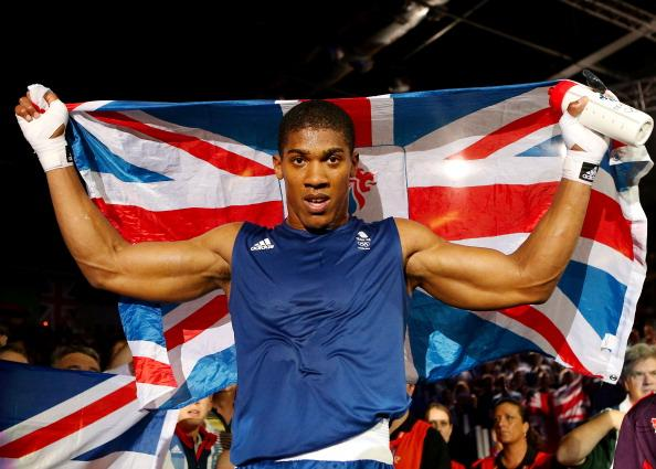 Anthony Joshua of Great Britain celebrates defeating Roberto Cammarelle of Italy to win the Men's Super Heavy ( 91kg) Boxing final bout on Day 16 of the London 2012 Olympic Games at ExCeL on August 12, 2012 in London, England. (Photo by Scott Heavey/Getty Images)