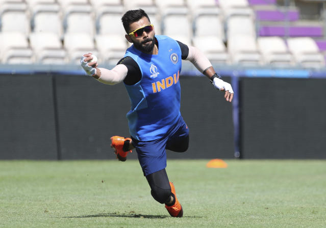 India's captain Virat Kohli dives to catch the ball during a training session ahead of their Cricket World Cup match against South Africa at Ageas Bowl in Southampton, England, Saturday, June 1, 2019. (AP Photo/Aijaz Rahi)