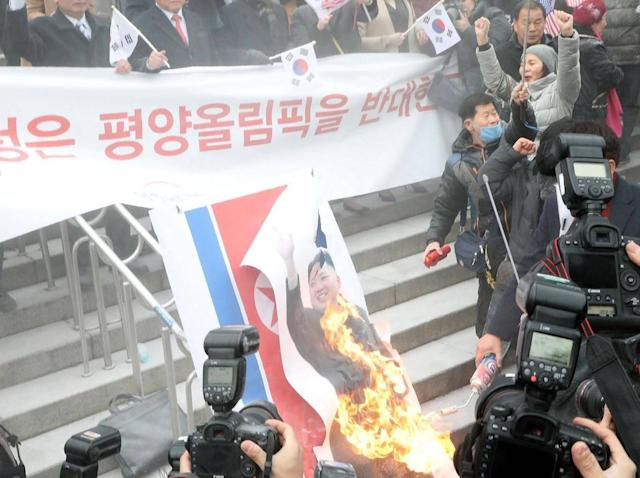 Activists burn a portrait of Kim Jong-Un (Getty Images)
