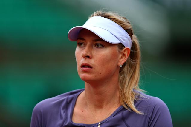 PARIS, FRANCE - MAY 30: Maria Sharapova of Russia looks on during her Women's Singles match against Eugenie Bouchard of Canada during day five of the French Open at Roland Garros on May 30, 2013 in Paris, France. (Photo by Clive Brunskill/Getty Images)