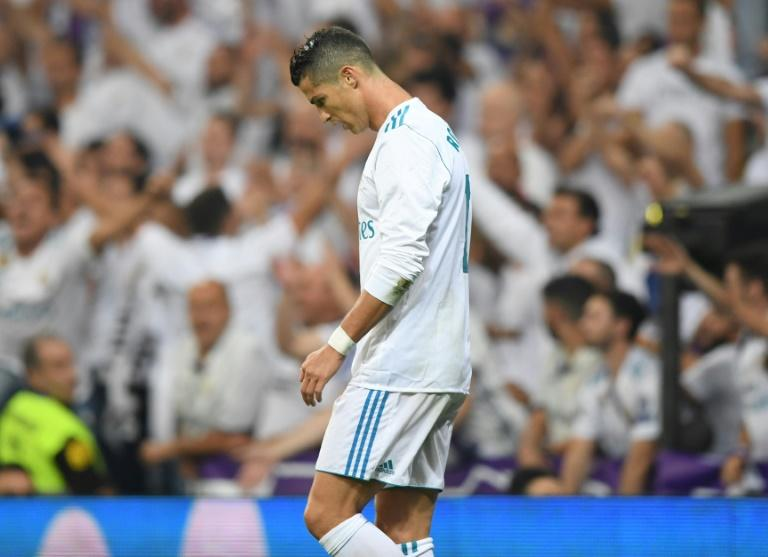 Real Madrid's forward from Cristiano Ronaldo looks downwards during the Spanish league football match against Real Betis at the Santiago Bernabeu stadium in Madrid on September 20, 2017
