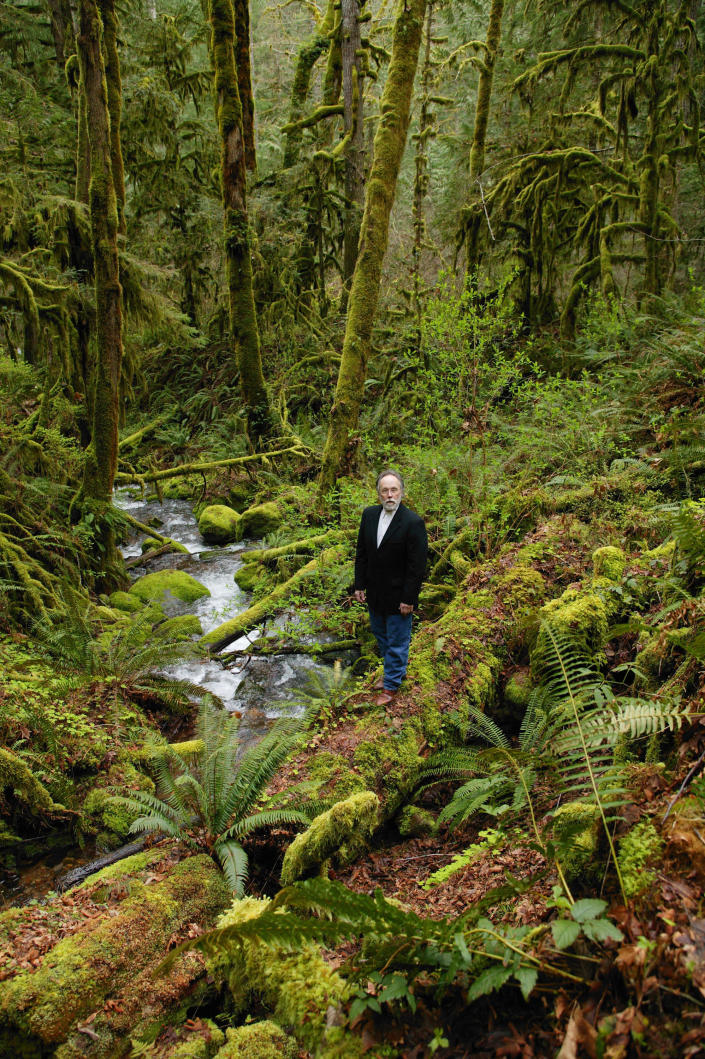 """This March 24, 2003 courtesy photo released by Natural History photographer David Liittschwager, shows writer Barry Lopez near Blue River, Oregon. Barry Lopez, an award-winning writer who tried to tighten the bonds between people and place by describing the landscapes he saw in 50 years of travel, has died. He was 75. His family said Lopez died in Eugene, Oregon, on Friday, Dec. 25, 2020, after a years-long struggle with prostate cancer. An author of nearly 20 books on natural history studies, along with an essay and short story collections, Lopez was awarded the National Book Award in 1986 for """"Arctic Dreams: Imagination and Desire in a Northern Landscape."""" It was the result of almost five years of traveling the Arctic. (David Liittschwager via AP)"""
