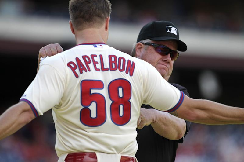 Philadelphia Phillies pitcher Jonathan Papelbon argues with Umpire Joe West after being ejected from the game against the Miami Marlins in the ninth inning of a baseball game Sunday, Sept. 14, 2014, in Philadelphia.