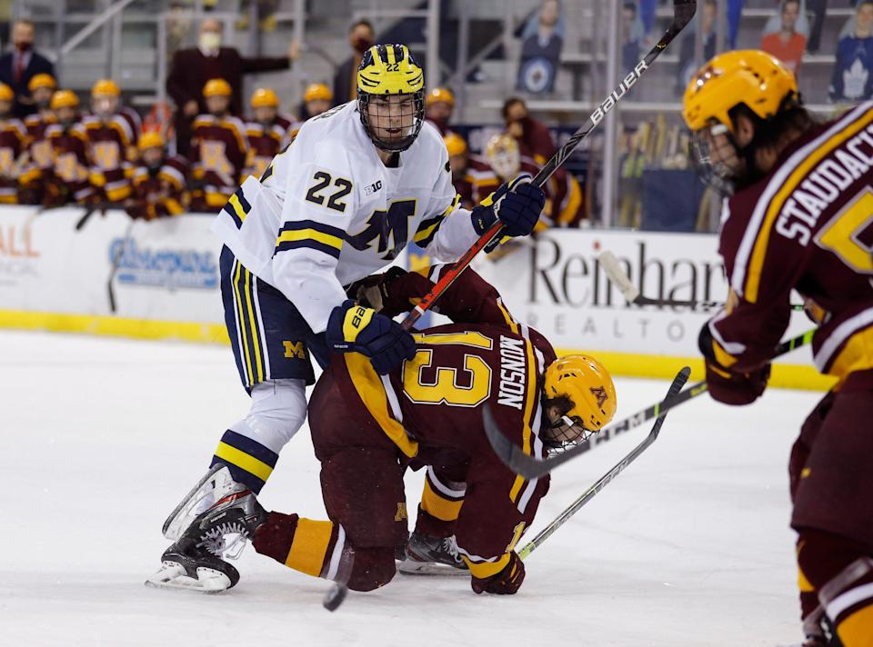 Defenseman Owen Power will return for his sophomore season at the University of Michigan, according to reports.