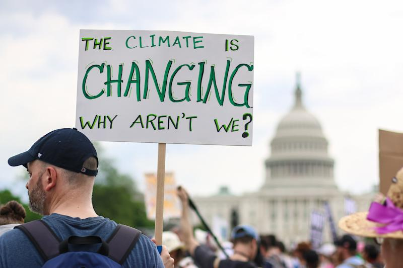 Thousands of people attend the People's Climate March to stand up against climate change in Washington, D.C. (Photo: Shutterstock/Nicole S Glass)