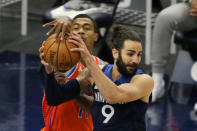 Oklahoma City Thunder guard Theo Maledon (11) tries to take a rebound away from Minnesota Timberwolves guard Ricky Rubio (9) during the first quarter during an NBA basketball game Monday, March 22, 2021, in Minneapolis. (AP Photo/Andy Clayton-King)