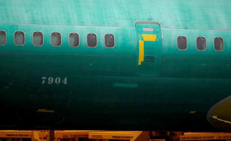 FILE PHOTO: The side of a Boeing 737 Max fuselage is seen parked outside the company's production facility in Renton