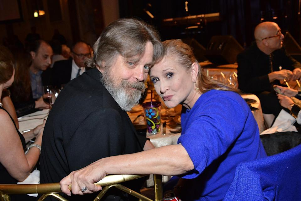 <p>Mark Hamill, left, paid tribute to Carrie Fisher, right</p> (Araya Diaz/Getty Images)