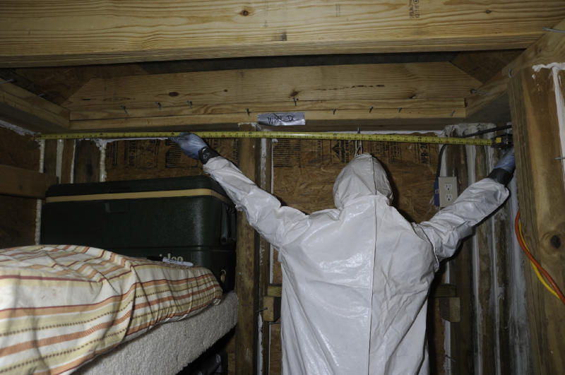 In this February 2013 photo provided by the FBI, the underground bunker of Jimmy Lee Dykes who kept authorities at bay during a six-day bunker hostage standoff, is measured, near Midland City, Ala. An FBI hostage rescue team stormed the bunker in early February, killing Dykes before he harmed his 5-year-old hostage or detonated an improvised explosive that authorities said was in the 6-foot by 8-foot shelter. (AP Photo/FBI)