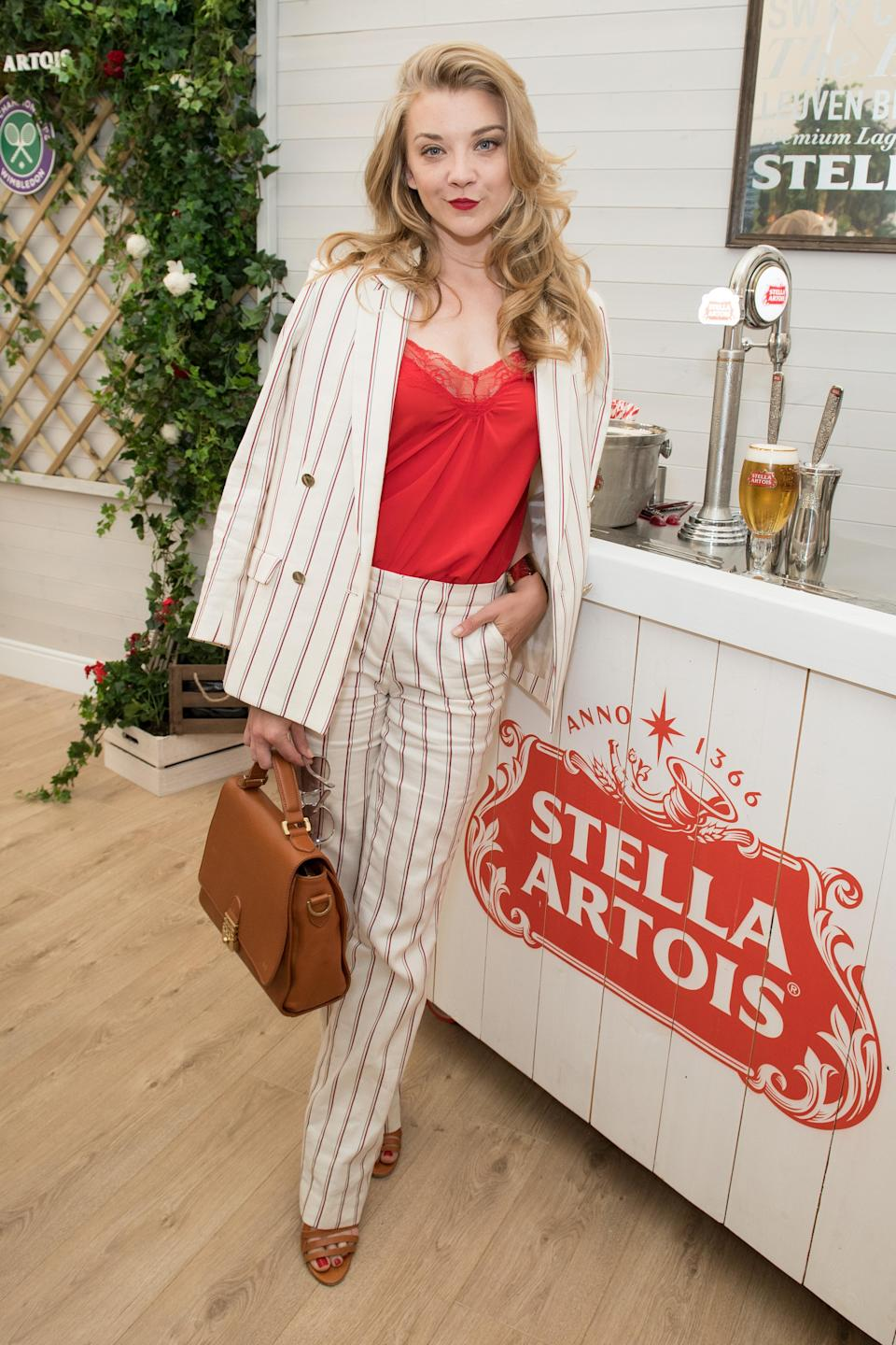 <p>Actress Natalie Dormer gave us lessons in summer suiting courtesy of a pinstripe co-ord on day two of the tennis tournament. <em>[Photo: Getty]</em> </p>
