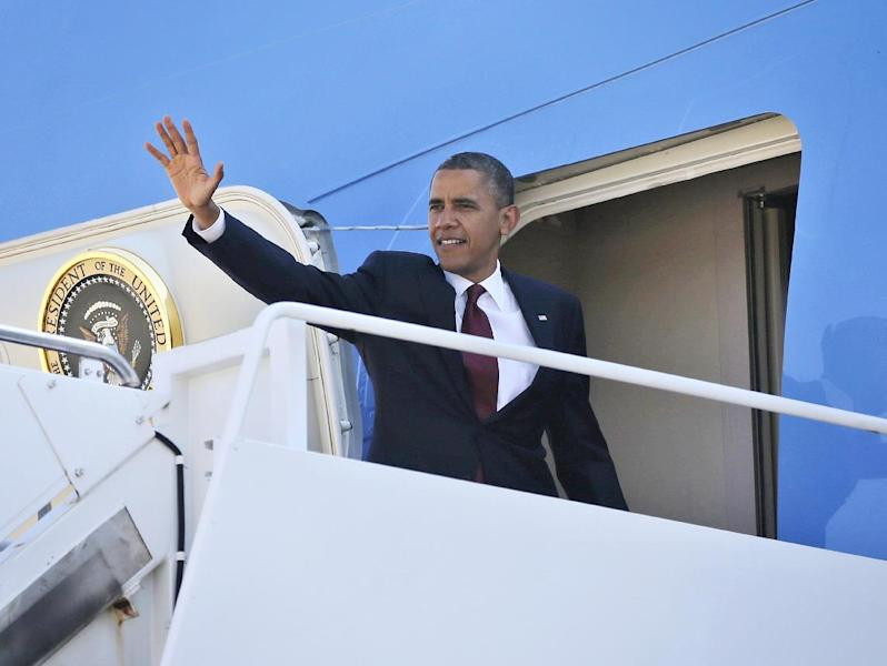 President Barack Obama waves as he boards Air Force One before his departure from Andrews Air Force Base, Md., Friday, Aug., 31, 2012. Obama is traveling to Fort Bliss in Texas to meet with members of military. (AP Photo/Pablo Martinez Monsivais)