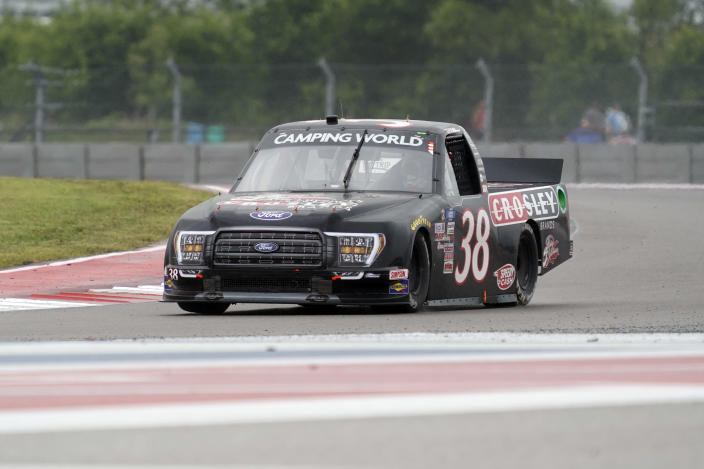 Todd Gilliland (38) drives out of Turn 17 during the NASCAR Truck Series auto race at the Circuit of the Americas in Austin, Texas, Saturday, May 22, 2021. (AP Photo/Chuck Burton)