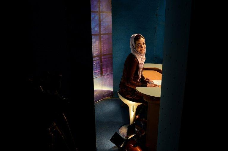 A news presenter prepares to read the news at a studio in Kabul on January 30, 2013. Afghanistan's first Internet TV station tackles subjects that the mainstream channels prefer to ignore