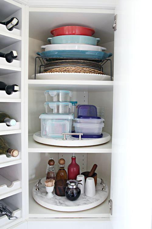 """<p>Organize seemingly random items, and you might find they all have a lot more in common than you realized (bakeware, tupperware, and condiments!). Lazy Susans make sure nothing gets pushed into the back and forgotten.</p><p><em><a href=""""http://www.iheartorganizing.com/2015/11/organized-kitchen-corner-cabinet-with.html"""" rel=""""nofollow noopener"""" target=""""_blank"""" data-ylk=""""slk:See more at I Heart Organizing »"""" class=""""link rapid-noclick-resp"""">See more at I Heart Organizing »</a></em></p><p><strong>What you'll need: </strong><span class=""""redactor-invisible-space"""">Lazy Susans, $10, <a href=""""https://www.amazon.com/InterDesign-Linus-Susan-Cabinet-Turntable/dp/B002BRSEVM/?tag=syn-yahoo-20&ascsubtag=%5Bartid%7C10072.g.36006557%5Bsrc%7Cyahoo-us"""" rel=""""nofollow noopener"""" target=""""_blank"""" data-ylk=""""slk:amazon.com"""" class=""""link rapid-noclick-resp"""">amazon.com</a></span><br></p>"""