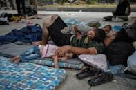 Around 100 mostly Afghan refugees have been camping in Athens under temperatures exceeding 30 degrees Celsius