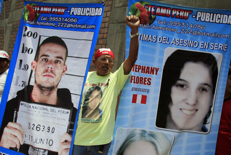 A man in Lima, Peru, holds posters of Dutch citizen Joran Van der Sloot and Peruvian girl Stephany Flores outside the Lurigancho prison, where van der Sloot was being read his sentence for murdering Flores in 2012. Van der Sloot was sentenced to 28 years in prison. (Pilar Olivares / Reuters)