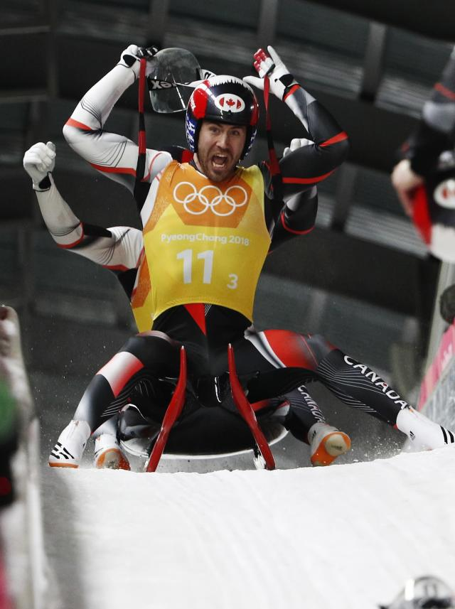 Luge - Pyeongchang 2018 Winter Olympic Games - Team Relay - Pyeongchang, South Korea - February 15, 2018 - Tristan Walker and Justin Snith of Canada react after finishing. REUTERS/Edgar Su