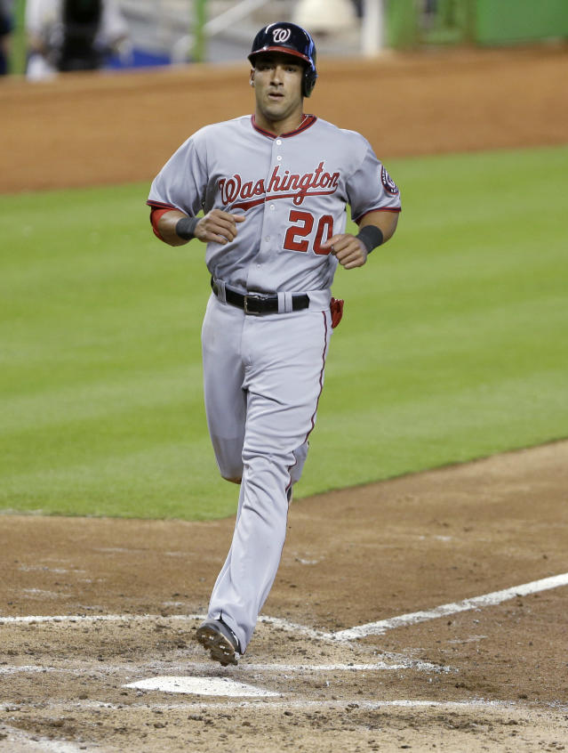 Washington Nationals' Ian Desmond crosses the plate as he scores on a single by Wilson Ramos during the fifth inning of a baseball game against the Miami Marlins, Sunday, Sept. 8, 2013, in Miami. The Nationals defeated the Marlins 6-4. (AP Photo/Wilfredo Lee)