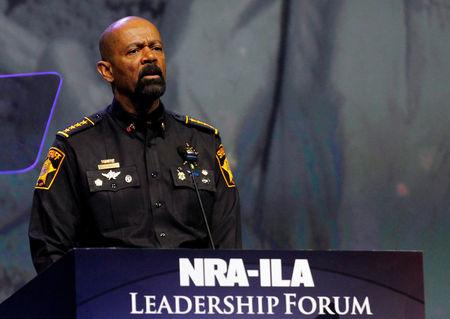 FILE PHOTO - Sheriff David Clark addresses members of the National Rifle Association during their NRA-ILA Leadership Forum at their annual meeting in Louisville, Kentucky, U.S. on May 20, 2016. REUTERS/John Sommers II/File Photo