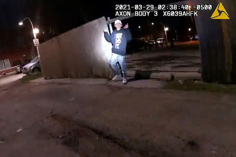 Adam Toledo, 13, holds up his hands a split second before he was shot by police