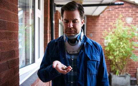 Rob Norris (played by Rob Delaney) is confined to a neck brace following his car crash - Credit:  Mark Johnson/Television Stills