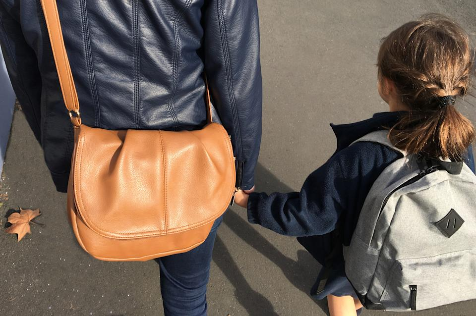 A school has started fining parents who are late to pick up their children after school [Photo: Getty]