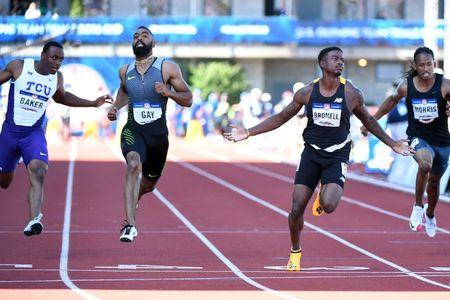 Jul 3, 2016; Eugene, OR, USA; Ronnie Baker (far left) and Tyson Gay (left) and Trayvon Bromell (middle) compete during the men's 100m semifinals heats in the 2016 U.S. Olympic track and field team trials at Hayward Field. Mandatory Credit: James Lang-USA TODAY Sports