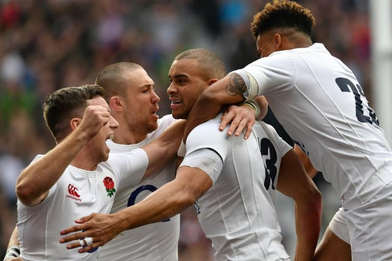 England's Jonathan Joseph (2R) celebrates with teammates after scoring his team's first try during their Six Nations international rugby union match against Scotland on March 11, 2017