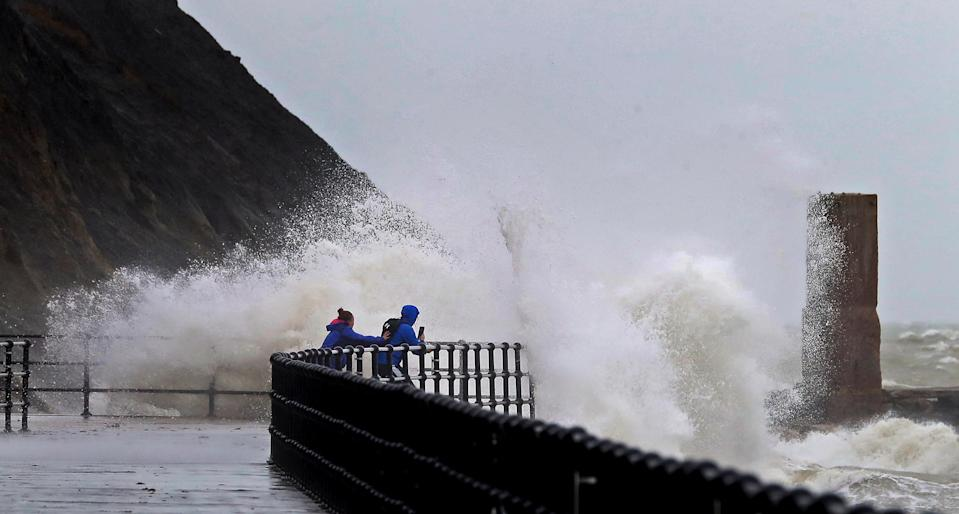 Impressive waves hit the harbour wall in Folkestone, Kent, over the weekend, prompting some people to try to capture the moment. (PA)