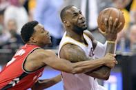 May 19, 2016; Cleveland, OH, USA; Toronto Raptors guard Kyle Lowry (7) fouls Cleveland Cavaliers forward LeBron James (23) during the second half in game two of the Eastern conference finals of the NBA Playoffs at Quicken Loans Arena. The Cavaliers won 108-89. Mandatory Credit: Ken Blaze-USA TODAY Sports