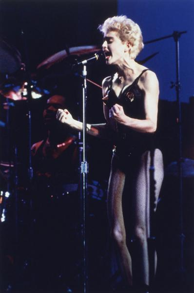 "<div class=""caption-credit""> Photo by: AP</div><div class=""caption-title""></div><b>""Who's That Girl?"" tour in Miami, 1987</b> <br> Wearing a black lace corset and fishnets on stage was risqué back then, but it's just another outfit for today's stars like Lady Gaga."