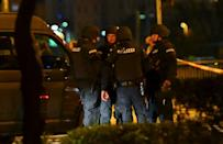 One of the gunmen was shot dead by police who said they were hunting for at least one more attacker still at large
