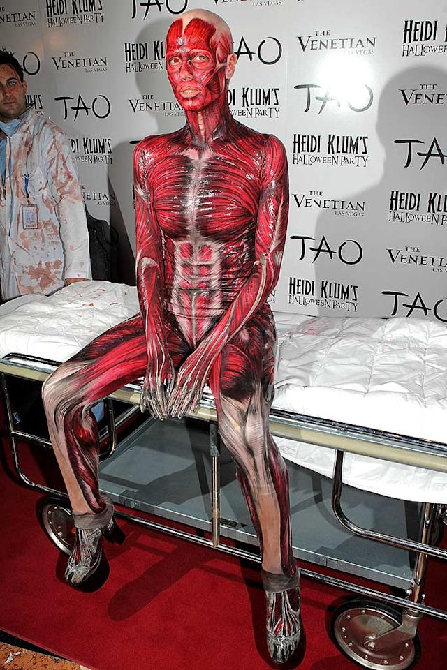 Heidi Klum made a dramatic entrance at her 13th annual Halloween bash, which she hosted at Tao nightclub in Las Vegas, dressed as a dead body. But before the reveal,  the supermodel was covered by a white sheet and pushed down the red carpet on a gurney by two blood-spattered doctors. Her creepy face makeup reportedly took three-and-a-half hours! (10/29/2011)