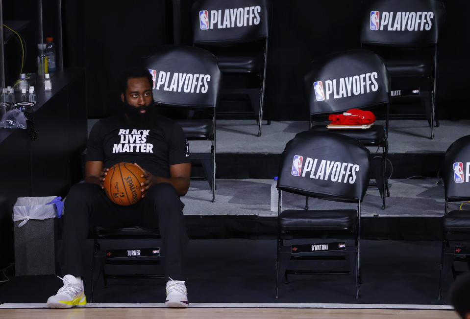 James Harden alone on the bench.