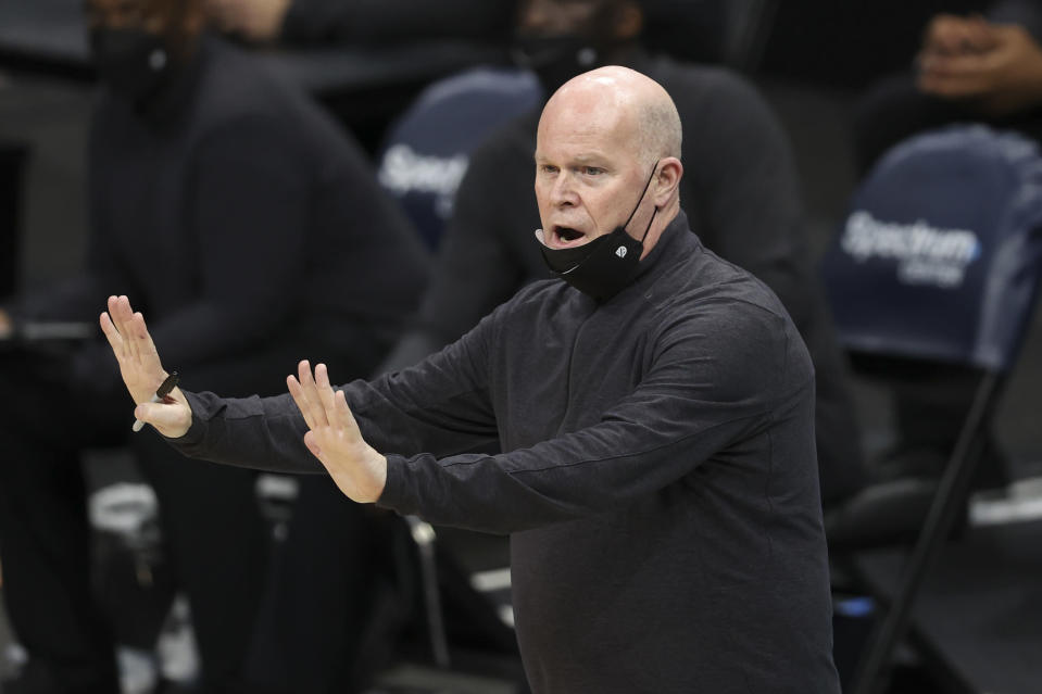 Orlando Magic coach Steve Clifford argues an official's call during the first half of the team's NBA basketball game against the Charlotte Hornets in Charlotte, N.C., Friday, May 7, 2021. (AP Photo/Nell Redmond)