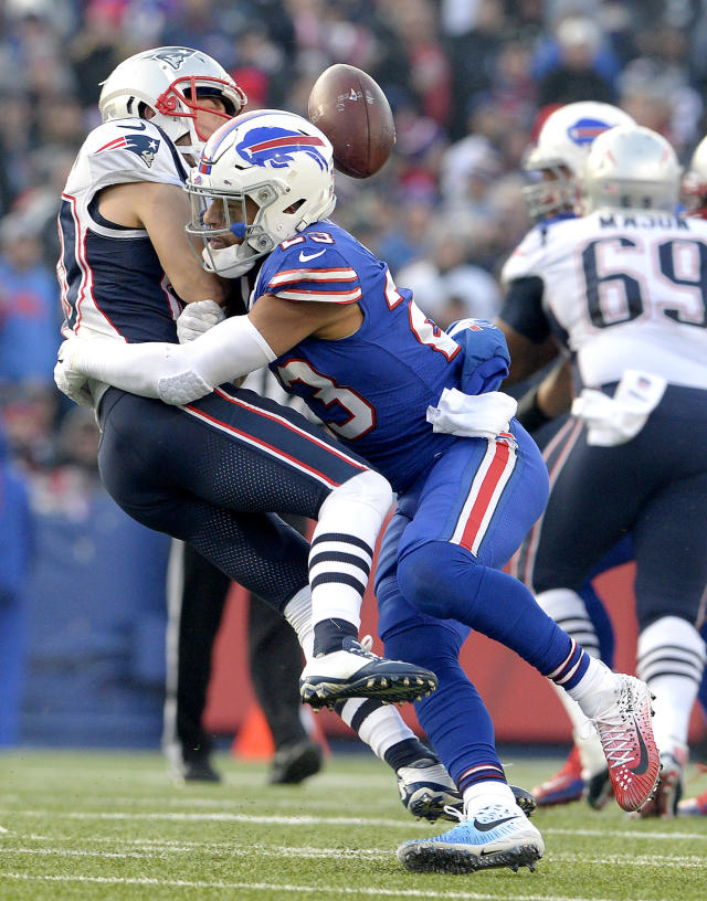 FILE - In this Dec. 3, 2017, file photo, Buffalo Bills strong safety Micah Hyde (23) hits New England Patriots wide receiver Danny Amendola (80) during the second half of an NFL football game in Orchard Park, N.Y. The continuity the Bills have established on defense over the past three years has plenty of benefits and, perhaps, one drawback. Hyde said he and Buffalo's 10 returning defensive starters were so far ahead during the offseason re-introductory phase last spring the sessions felt a little too repetitive. (AP Photo/Adrian Kraus, File)