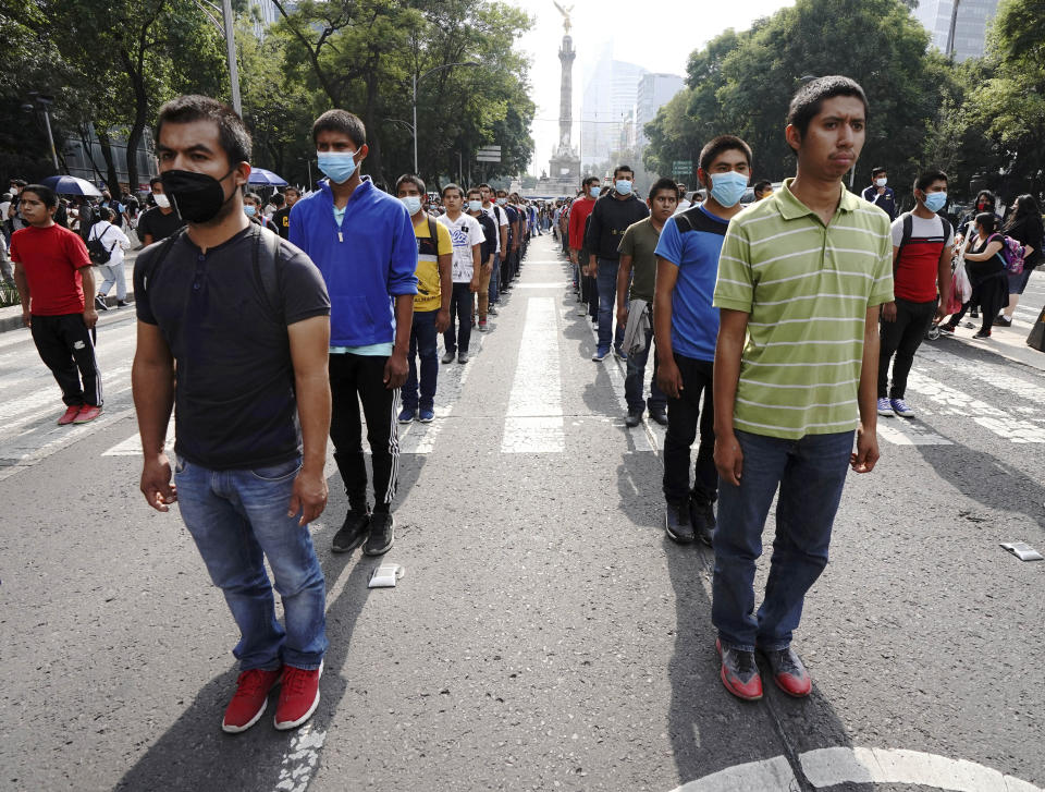 Supporters and relatives of 43 missing university students march on the seventh anniversary of their disappearance, in Mexico City, Sunday, Sept. 26, 2021. Relatives continue to demand justice for the Ayotzinapa students who were allegedly taken from the buses by the local police and handed over to a gang of drug traffickers. (AP Photo/Marco Ugarte)