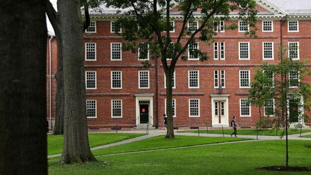 PHOTO: People walk across Harvard Yard on the campus of Harvard University on July 08, 2020, in Cambridge, Mass. (Maddie Meyer/Getty Images)