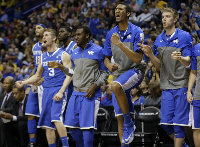 Kentucky reaches against Wichita State during the second half of a third-round game of the NCAA college basketball tournament Sunday, March 23, 2014, in St. Louis. (AP Photo/Charlie Riedel)