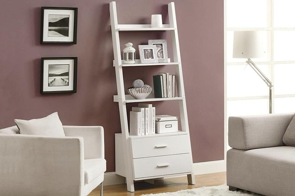 <p>Almost 70 percent of reviewers on Amazon gave the <span>Monarch Specialties Bookcase With Ladder and 2-Storage Drawers</span> ($256, originally $338) a four-star rating or higher. The two drawers add extra storage space to this stylish set of shelves.</p>