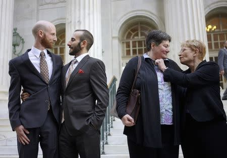 File photo of plaintiffs talk outside the courthouse after a federal appeals court heard oral arguments on a Utah state law forbidding gays and lesbians from marrying in Denver