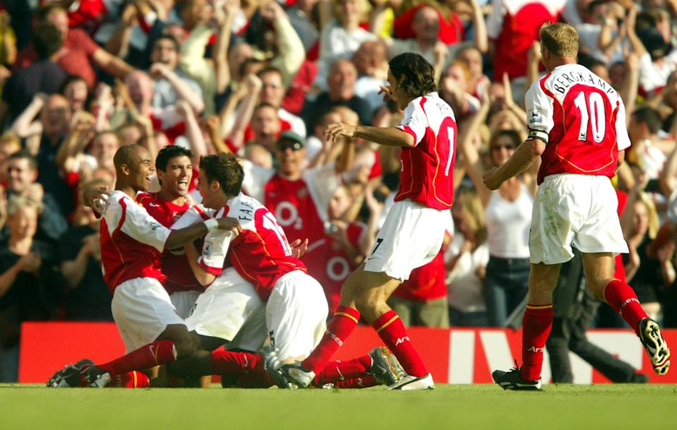 Reyes celebrates his goal with the rest of the squad - who will go on to be labelled 'Invincibles' (Photo by Mike Egerton - EMPICS/PA Images via Getty Images)
