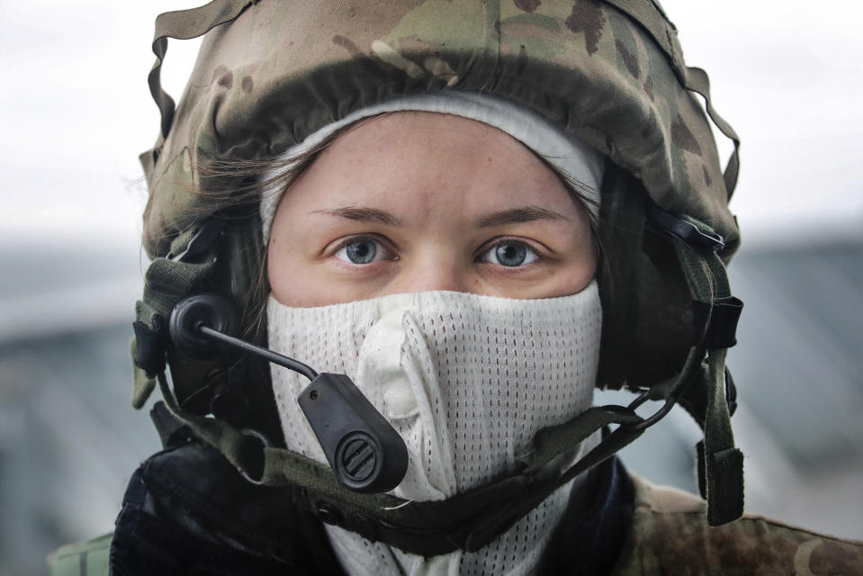 Image of a female sailor onboard HMS Albion, taking part in a simulated attack exercise (Picture: UK MOD/Crown 2019)