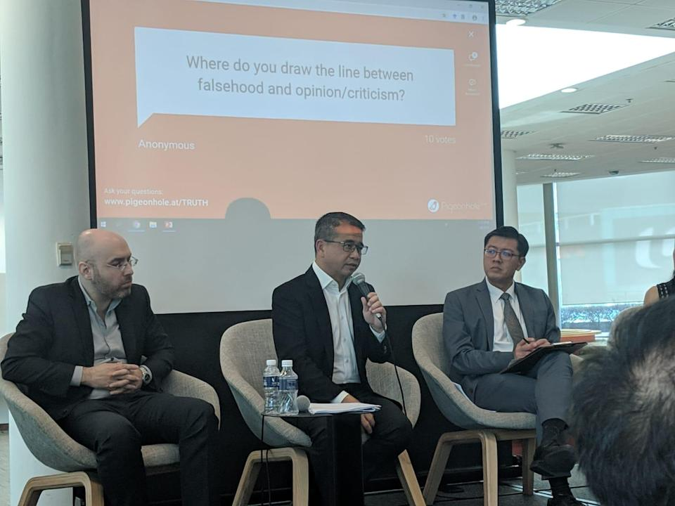 From left to right: SMU Assistant Professor of Sociology Michel Genkin, Senior Minister of State for Law and Health Edwin Tong and SMU Associate Professor of Law and panel moderator Eugene Tan. (PHOTO: Yahoo News Singapore)