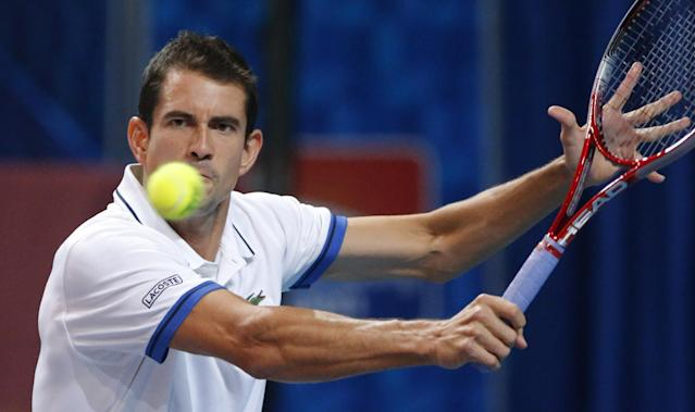 Guillermo Garcia-Lopez of Spain returns the ball to Ernests Gulbis of Latvia during the St. Petersburg Open ATP tennis tournament final match in St.Petersburg, Russia, Sunday, Sept. 22, 2013. (AP Photo/Dmitry Lovetsky)