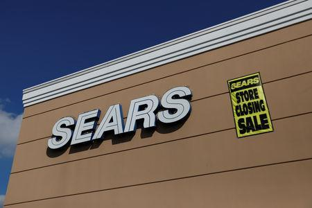 FILE PHOTO: A store closing sale sign is posted next to a Sears logo in New Hyde Park, New York, U.S., October 10, 2018. REUTERS/Shannon Stapleton