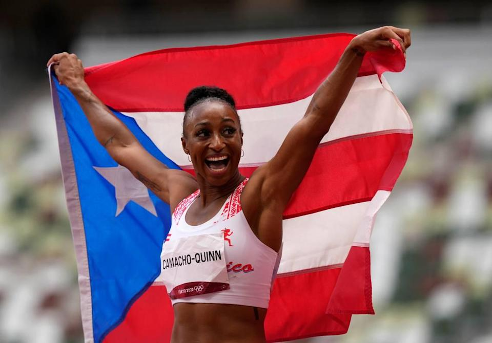 Former UK track and field star Jasmine Camacho-Quinn is Puerto Rico's first gold medal winner in an athletics event.