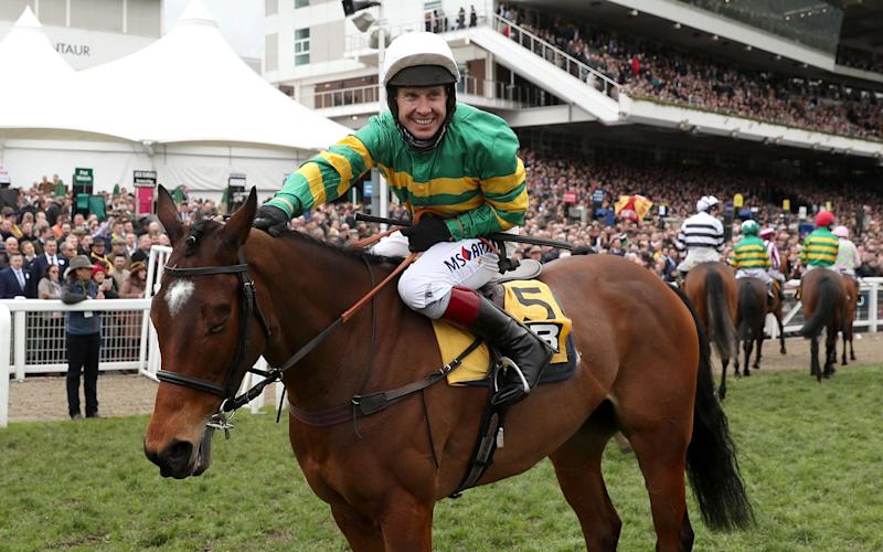 Richard Johnson celebrates after his winning ride on Defi Du Seuil in the JCB Triumph Hurdle - Credit: David Davies/PA Wire